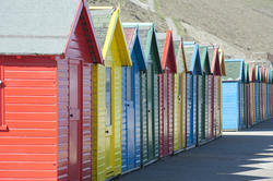 7865   Colourful wooden beach huts