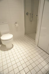 10668   White Tiled Flooring at the Bathroom