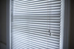 10648   Venetian blinds hanging in a window