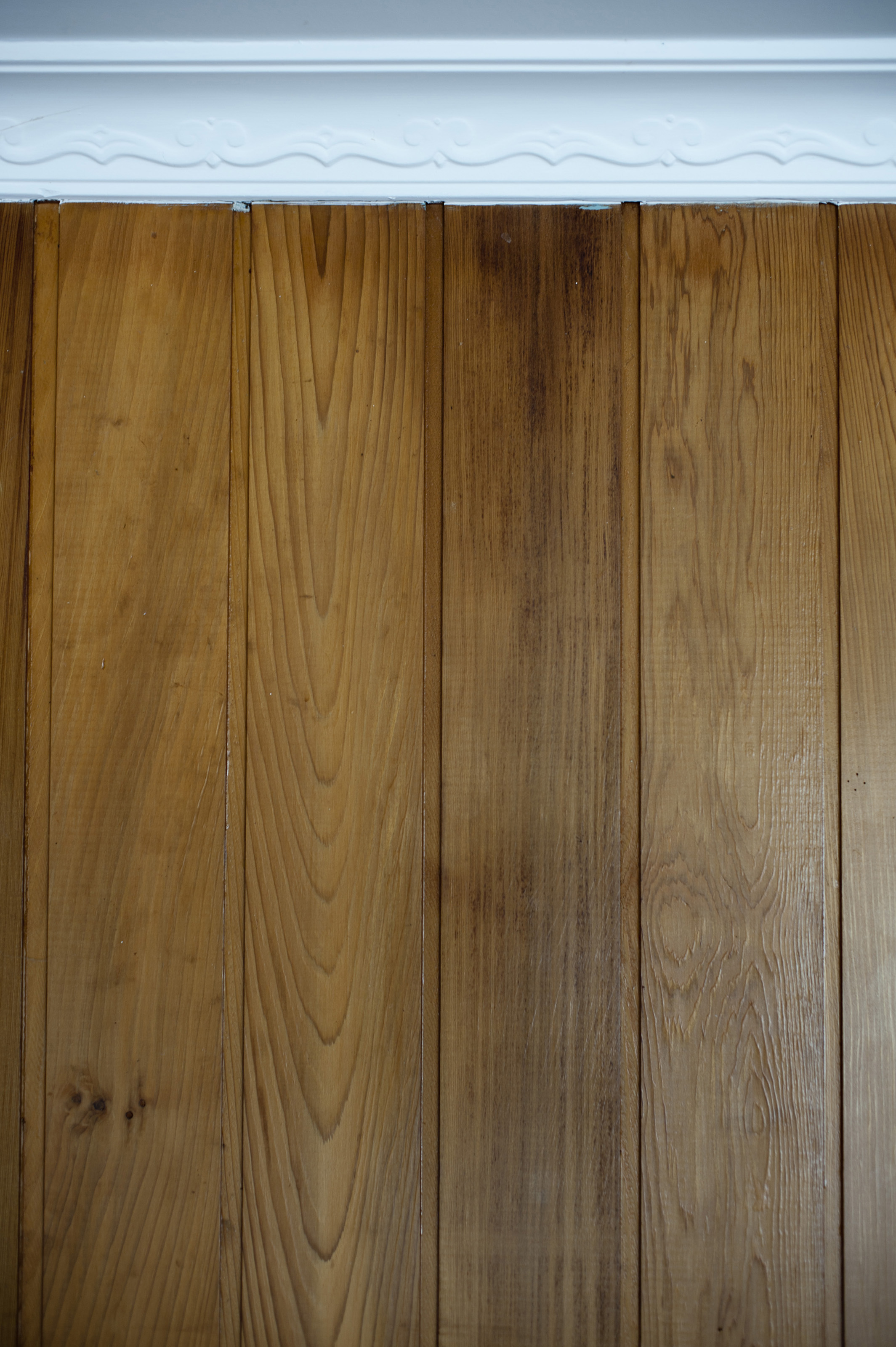 Close Up Of Architectural Decor Detail Laminate Wood Wall Paneling And  Decorative White Window Frame Border