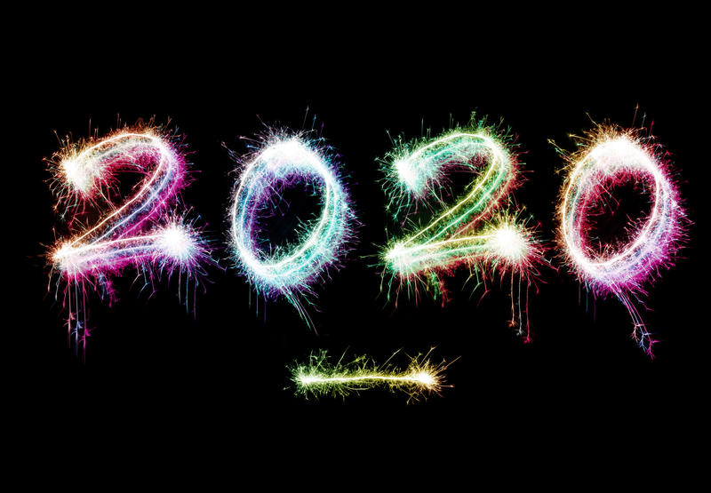 2020 New Year background with colorful sparklers forming a fiery date on a black background with copy space for a holiday greeting