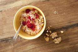 12258   Breakfast muesli in little bowl with fruit