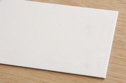 12728   Close up on half of white envelope