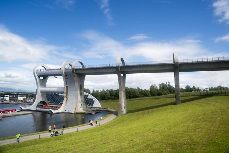 Sloping hill of well cut lawn under the famous Falkirk Wheel boat lift in Scotland