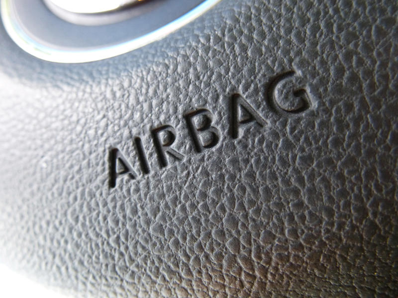 Extreme macro close up on airbag logo for steering wheel with rough textured surface