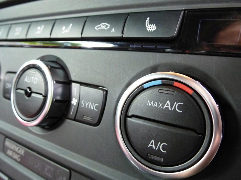 Wide angle close up view on environmental heating and air controls inside automobile