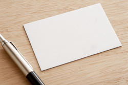 12729   Blank white card with a ball point pen