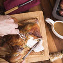 17168   Man carving the Christmas roast turkey for dinner