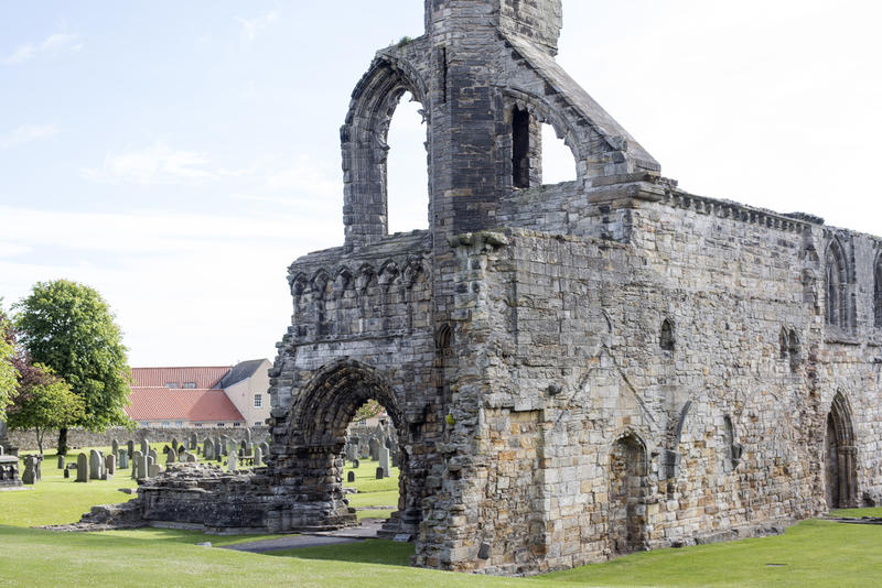 Section of the ruins of St Andrews Cathedral, Scotland showing the remnants of the Gothic arches and ancient stone walls in neatly manicured lawns