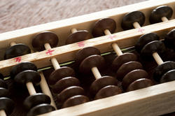 12719   Close up detail of a wooden abacus