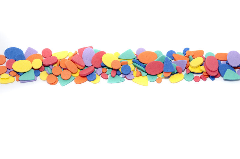 Colored shapes divider on white with a variety of different multicolored forms arranged in a row dividing the background into thirds with copy space