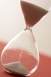 12949   Hourglass with sand pouring close up