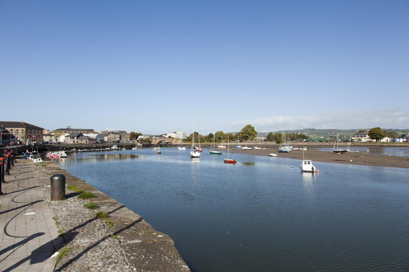<p>Davitts Quay, Dungarvan, County Waterford, Ireland. This image shows boats moored at low tide.</p>
