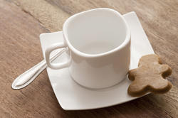 17152   Clean white coffee cup and saucer