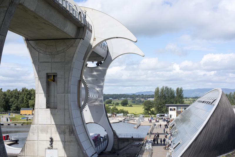 Birds eye view on round building and lift for Falkirk Wheel in Scotland under partly cloudy skies