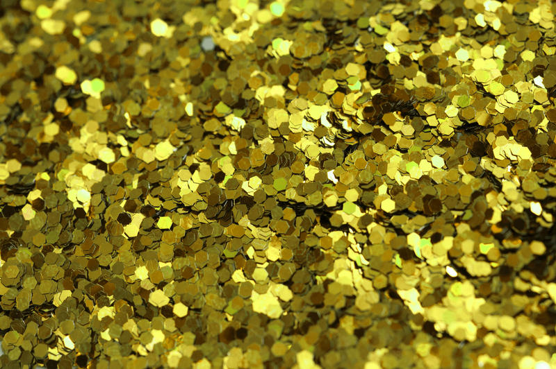 a background texture of gold coloured glitter flecks