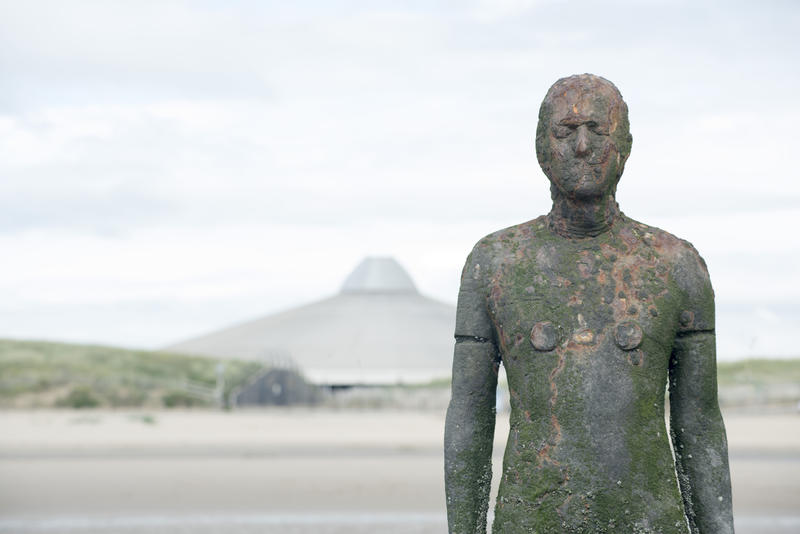 Close Up of Cast Iron Male Figure as part of Another Place Modern Sculpture Installation by Antony Gormley on Crosby Beach, England, UK