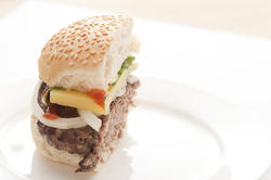 12757   Half hamburger with cheese on plate