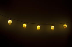 12779   String of glowing yellow Halloween skull lights