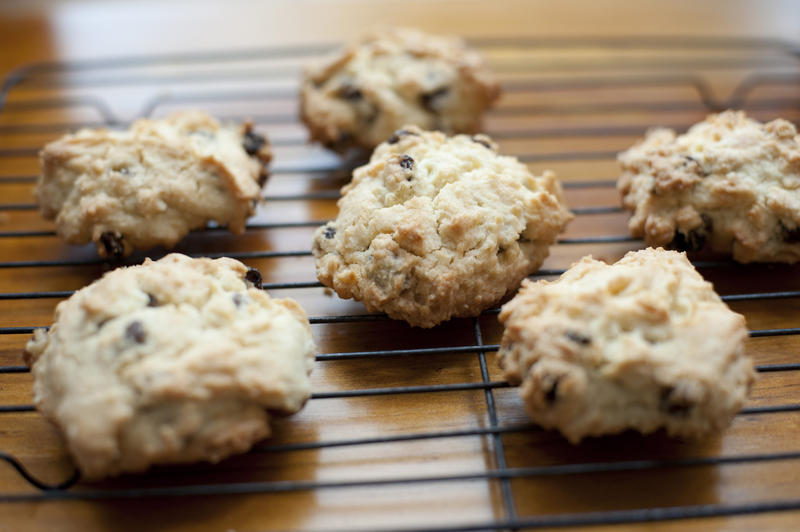 Set of six hot freshly baked crispy rock cake cookies on rack with center in focus