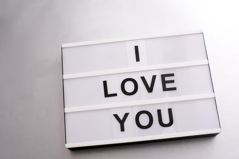 Changeable sign with I LOVE YOU letters on white background. Close-up over white surface