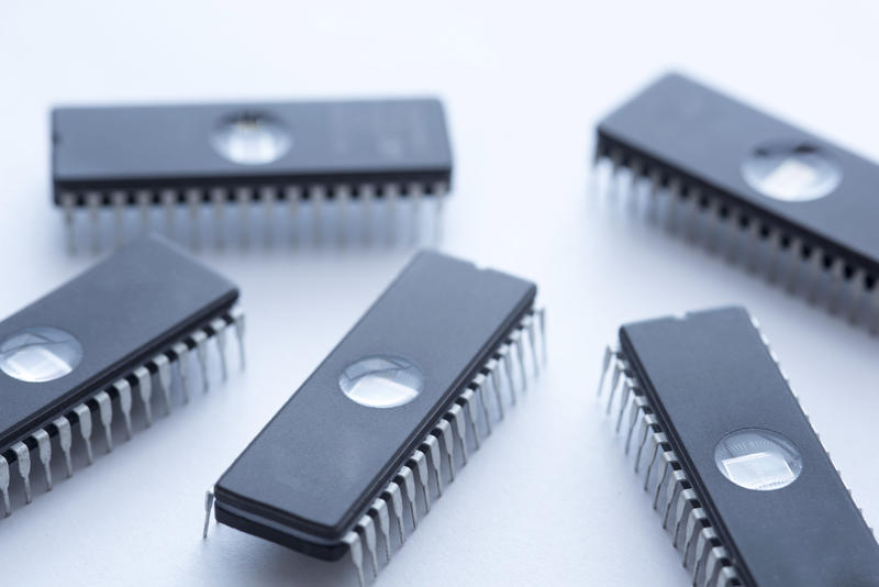 Black integrated circuit memory chips EEPROM on white surface background