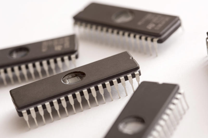 Integrated circuit memory chips, computer components close-up on white background