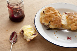 12337   scones, spoon, plate and jam