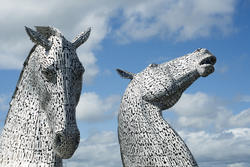 12855   The Kelpies, Falkirk, Scotland against a blue sky