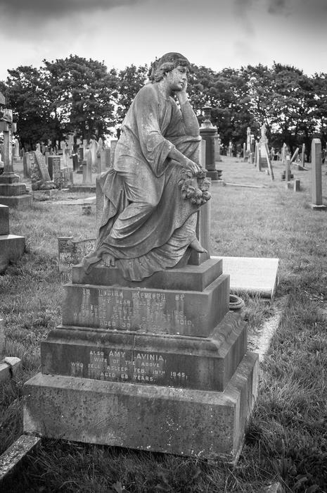 <p>A black and white photo of gravestone in a graveyard. Photographed in Layton Cemetery, Blackpool. UK.&nbsp;Layton Cem &nbsp;was opened in 1873 when Blackpool parish church was replete with burying. The site encompasses 30 acres, having been regularly expanded during its history.</p>