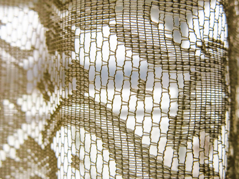 <p>Macrame lace window treatment curtain close up and intimate.</p>