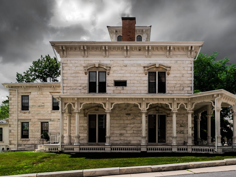 <p>Old marble hotel after the rains in rural Vermont with grey clouds and green grass. Haunted even in the daytime...</p>