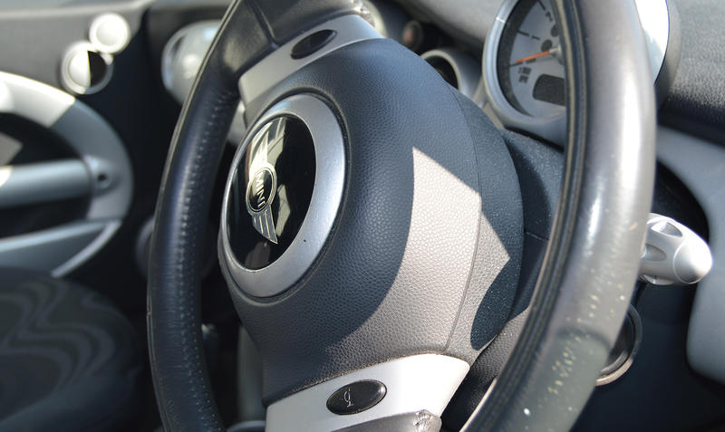 <p>Editorial use: The Steering Wheel&nbsp;of a BMW Mini One</p>