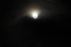 13062   moon reaching above the clouds