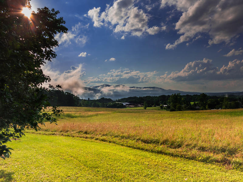 <p>Meadows, clouds and sky in rural Vermont.</p>