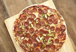 12762   Delicious salami Italian pizza