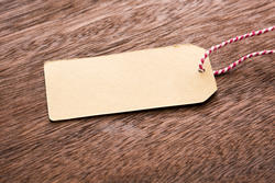 13130   Blank brown gift tag or label on wood