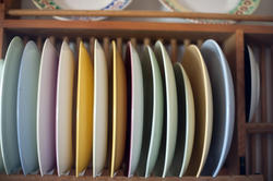 17162   Wooden rack with assorted colorful plates