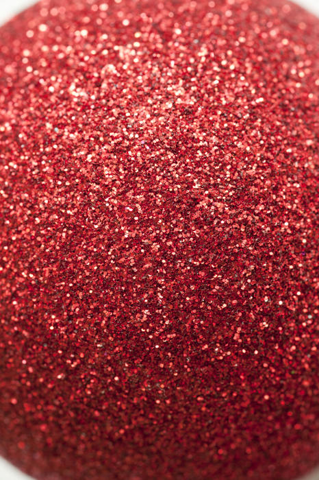 Extreme close up view on red glitter ornament ball