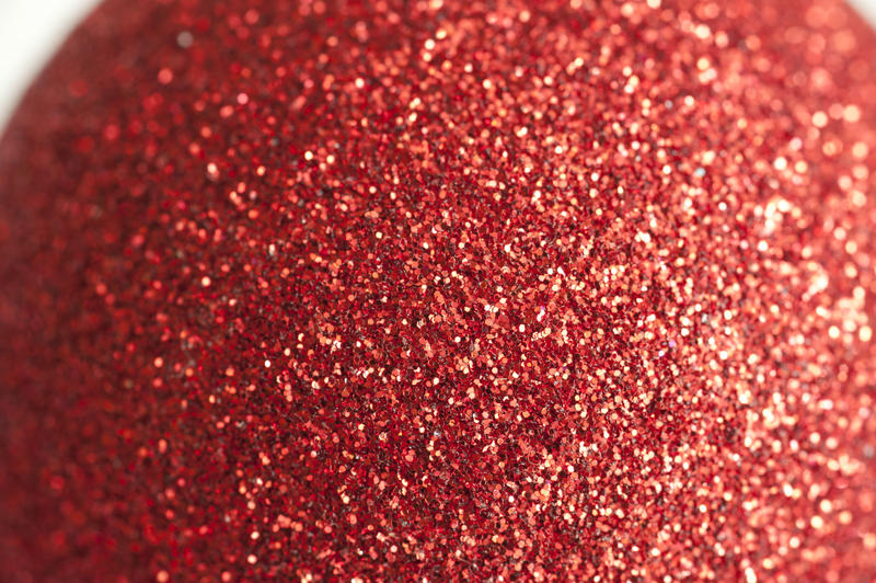 a close up image of a sparkly red glitter covered ball