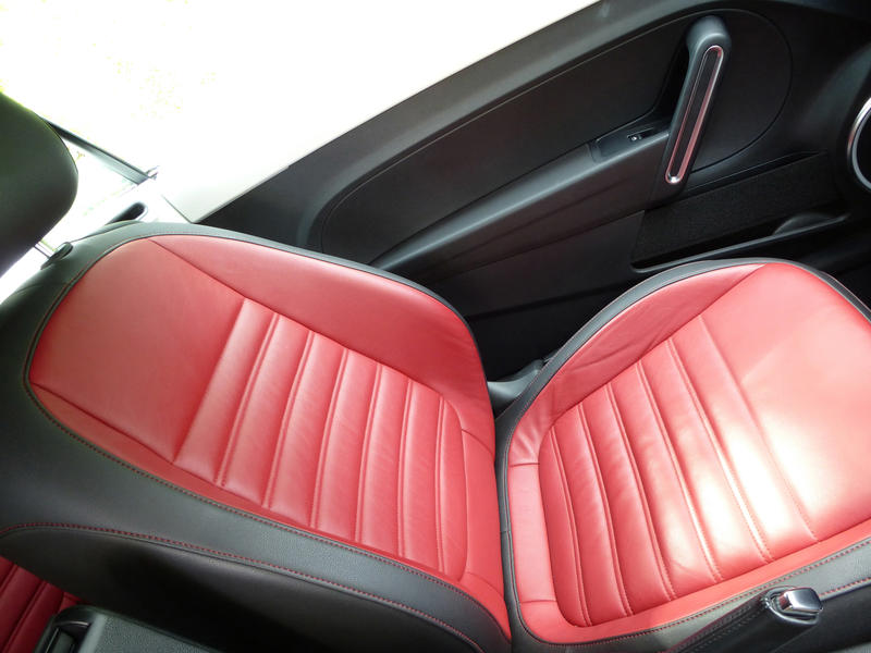 Colorful red leather seat with black trim in a modern car in a high angle view