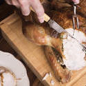 17175   Man slicing a roasted Christmas turkey