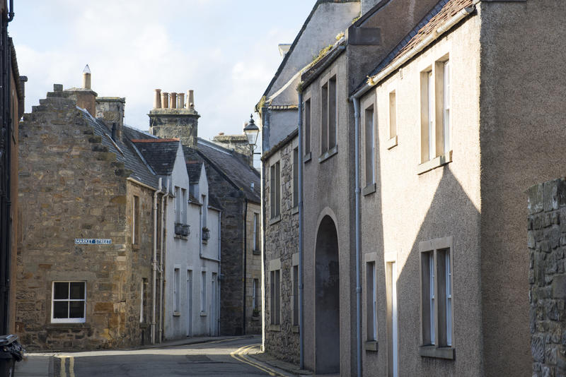 Narrow street with contrasty shadows in the small town of Saint Andrews, Scotland