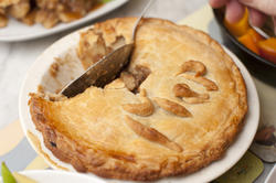 12307   serving a pie with a spoon
