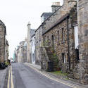 12866   Empty narrow street with old stone houses