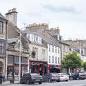 12868   Parked cars and tourists in Saint Andrews Scotland