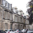 12850   Cars in front of homes in St Andrews, Scotland