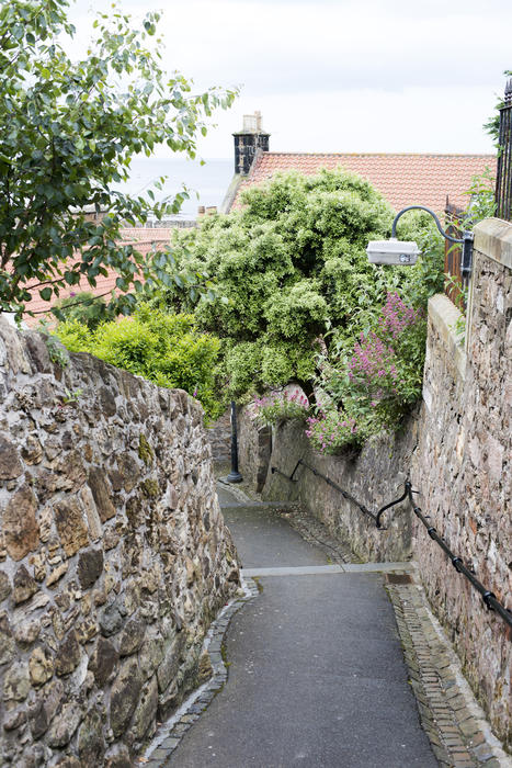 Narrow stone passage between houses, Pittenweem, Scotland a fishing village on the Fife coast