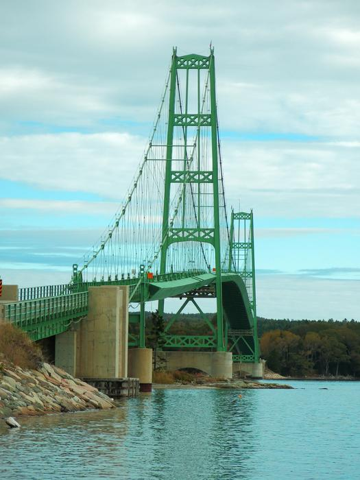 <p>Green suspension bridge connecting one small island to the Maine land on the coast of Maine.&nbsp;</p>