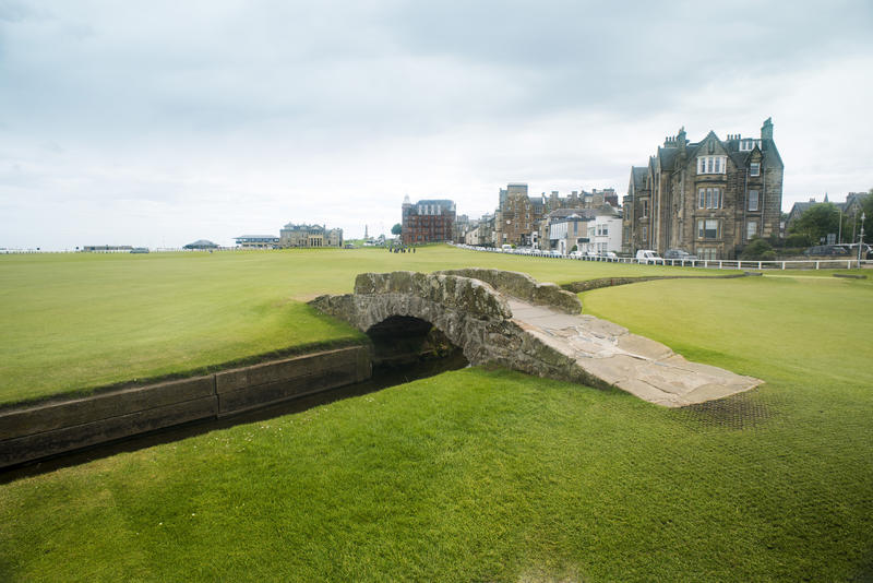 Little bridge over small canal at the empty green grass field of Saint Andrews Golf Course